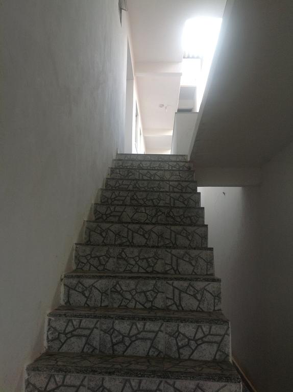 Escada acesso Aptos.