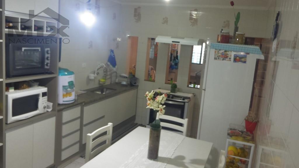 Vista da sala para cozinha + Lavanderia