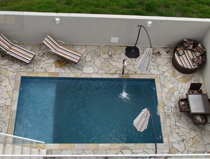 Ver mais detalhes de Casa com 3 Dormitórios  em Aldeia da Serra - Santana de Parnaíba/SP